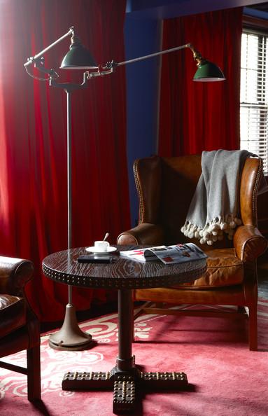 Hotels+Red+wooden+table+beside+pair+leather+SaaTsroYH6zl